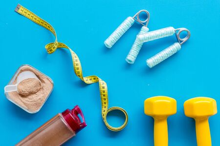 Sports nutrition and fitness tools on blue background top view 写真素材