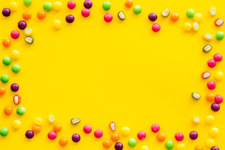 Candy dots frame for blog design on yellow background top view mock up