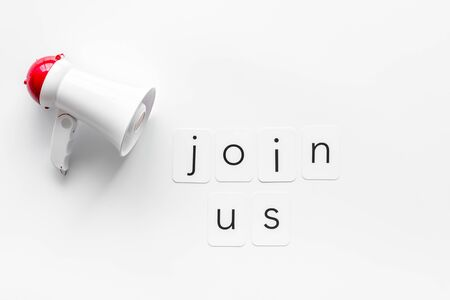 Join us text for announcement and megaphone on white background top view Banco de Imagens