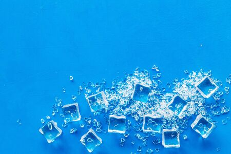 ice cubes on blue table top view mock-up