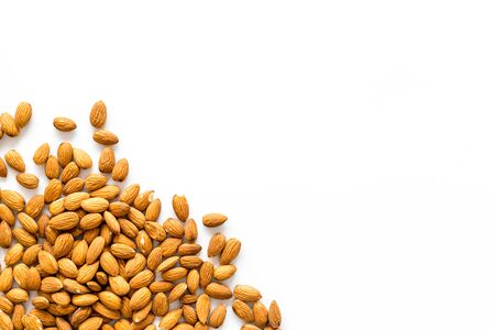 Almond on white background top view space for text