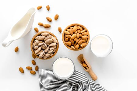 Almond milk in glass with almonds on white background top view Stock fotó