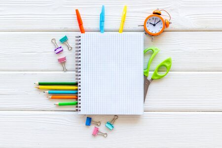 Creative mess on students desk on white wooden background top view mockup Imagens
