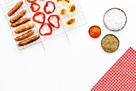 barbecue, sausages, vegetables on white background top view mock-up Imagens