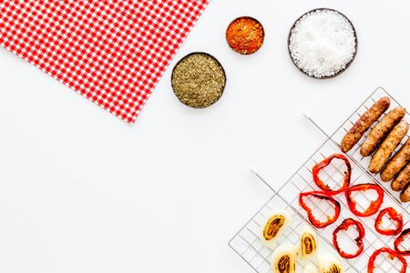 barbecue, sausages, vegetables on white background top view mockup