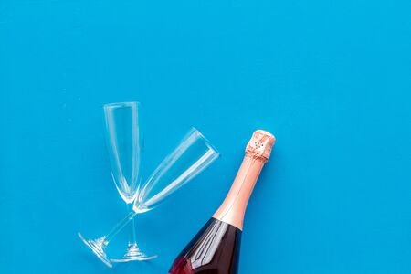 Festive and celebrate. Party with champagne bottle and glasses on blue background top view space for text