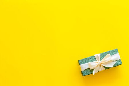 box for gifts on yellow background top view mock up 写真素材