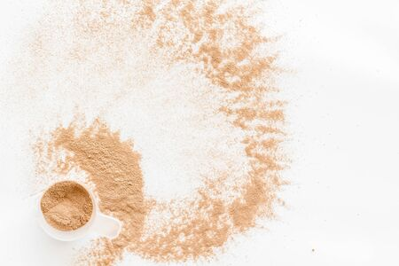 Nutrition for workout with protein cocktail powder on white background top view