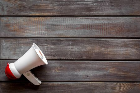 Announcement with megaphone on wooden background top view mockup
