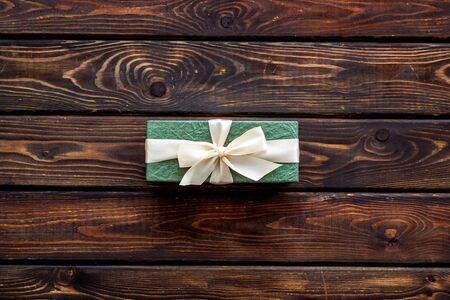 box for gifts on wooden background top view mock up