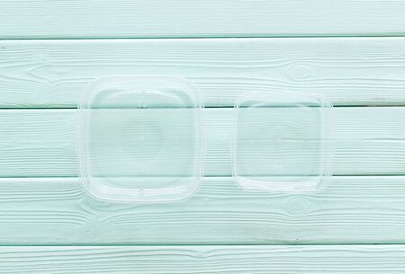 empty food container on mint green wooden background top view mockup