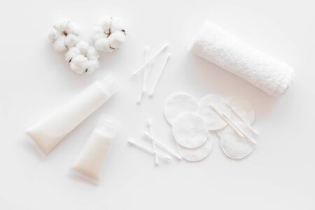 Hygiene cotton swabs, pads and cream for pattern on white background top view Stock Photo