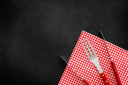set of used barbecue tools on black background top view mockup