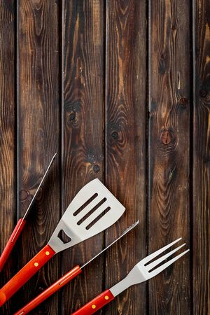 set of used barbecue tools on wooden background top view mockup Фото со стока - 128951141