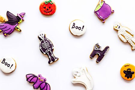 Halloween decorations on white background top view pattern
