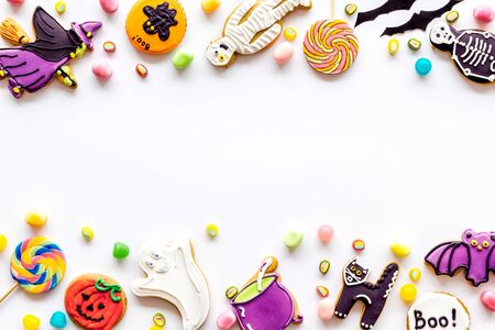 Halloween decorations frame on white background top view copyspace