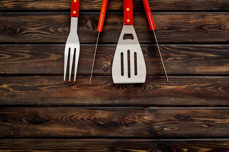 set of used barbecue tools on wooden background top view mock up Фото со стока