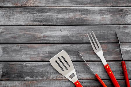 set of used barbecue tools on wooden background top view mockup