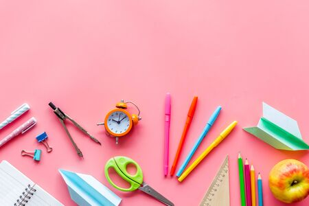 Creative mess on students desk on pink background top view mock up Imagens