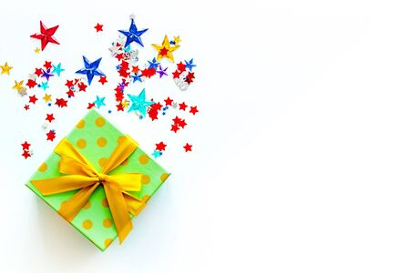 presents in boxes with confetti on white background top view copyspace