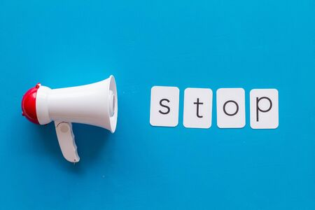 announce with stop copy and megaphone on blue background top view