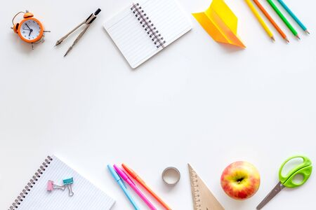 Creative mess on students desk on white background top view Imagens