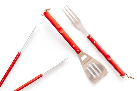 Tongs, fork, spatula for barbecue and grill on white background top view Фото со стока