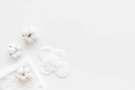 Cotton flowers with pads on white background top view mock up Stock Photo