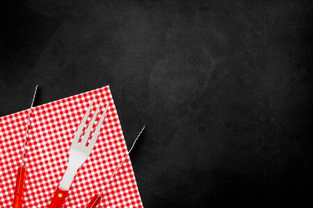 Fork, spatula for barbecue and grill on black background top view copyspace Imagens