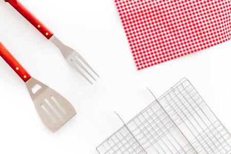 set of used barbecue tools on white background top view Imagens
