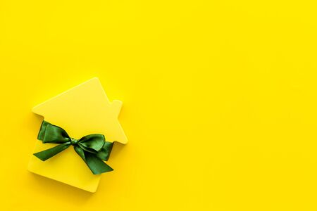 Inheritance house with figure on yellow background top view mockup Stok Fotoğraf - 129785940