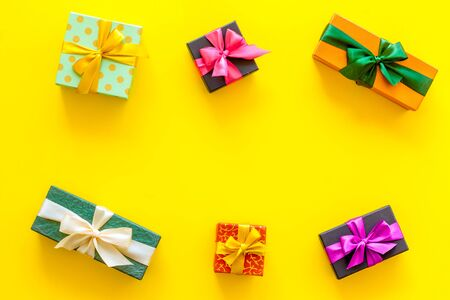 frame from boxes with presents on yellow background top view mockup
