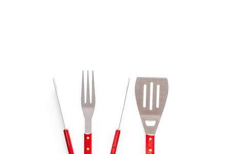 Tongs, fork, spatula for barbecue and grill on white background top view copyspace Imagens