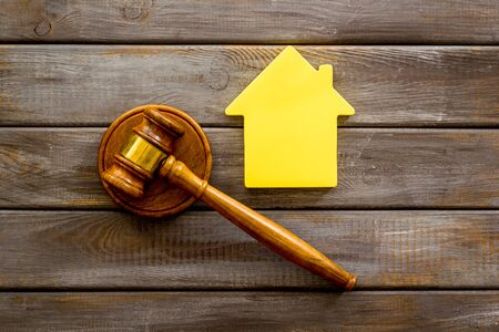 Inscribed gavel, house figure for inheritance concept on wooden background top view Banco de Imagens