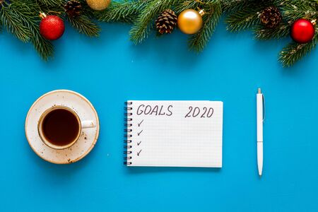 New Year goals concept. Notebook for writting resolution on blue background top view