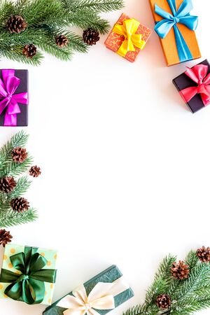 Presents for christmas in boxes and spruce frame on white background top veiw copyspace 写真素材