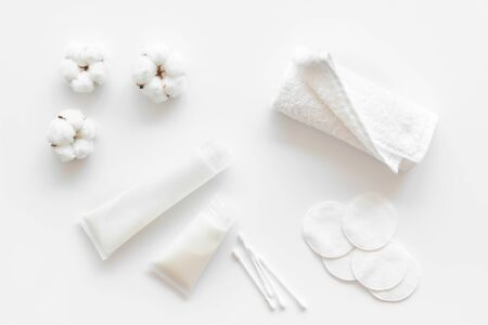 Cotton pads, swabs and cream for blog design on white background top view