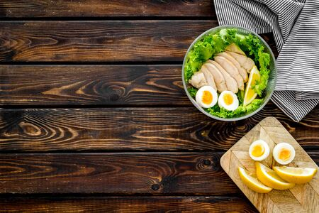 Salad bowl with healthy food for lunch at work place on wooden background top view space for text