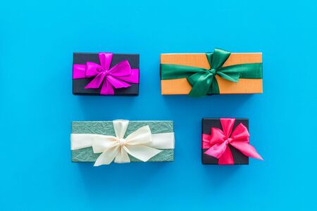 boxes with presents for holiday on blue background top view. Imagens