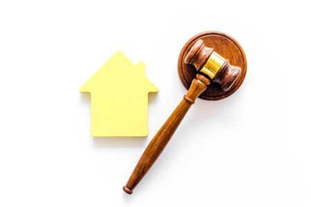 Inheritance of the house concept with house figure and inscribed gavel on white background top view Banco de Imagens