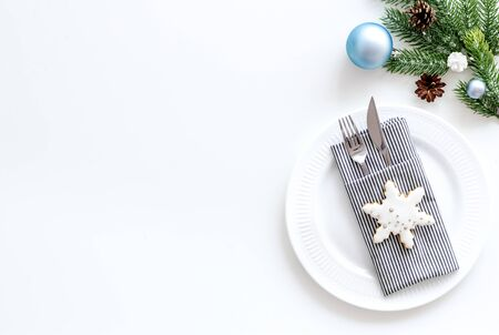 2020 year celebration with table setting, plate, fork, knife, spruce, ginger cookies on white background top view mock up