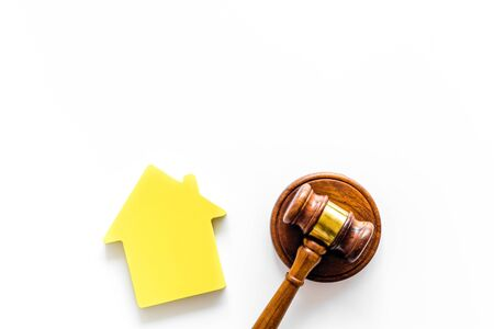 Inscribed gavel, house figure for inheritance concept on white background top view copyspace. Stock Photo