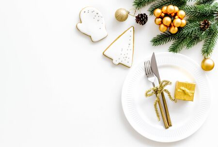 Christmas table setting with fir tree and gift in box on white background top view space for text Banco de Imagens