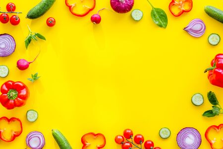 colorful vegetables frame for cooking design on yellow background top view mock up