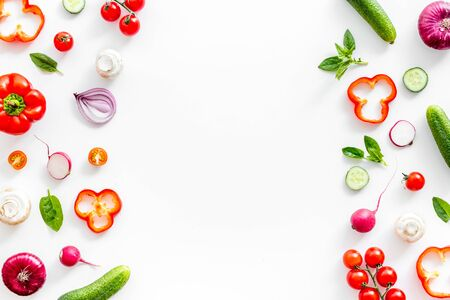 Cook frame with fresh vegetables on white background top view space for text