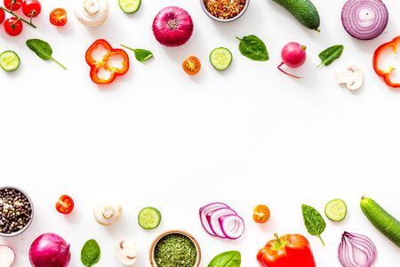 Sliced, cut, chopped vegetables frame on white background top view copy space