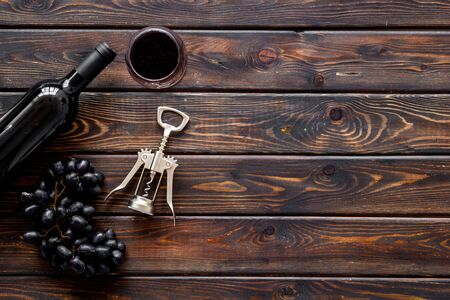 Open wine bottle. Top view dark wooden background copy space Фото со стока - 129680129