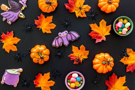Nice halloween background with sweets. Cookies and pumpkins on black top view. Kho ảnh