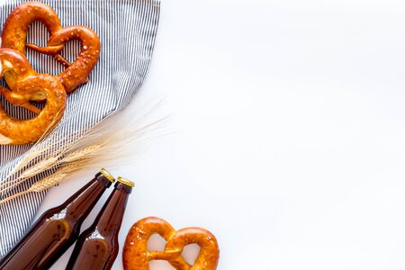 Pretzels near wheat and beer bottles top view