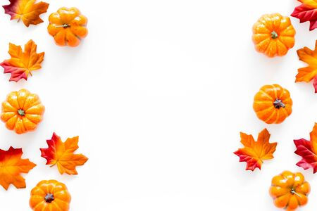 Autumn background with leaves and pumpkins on white top view copy space frame